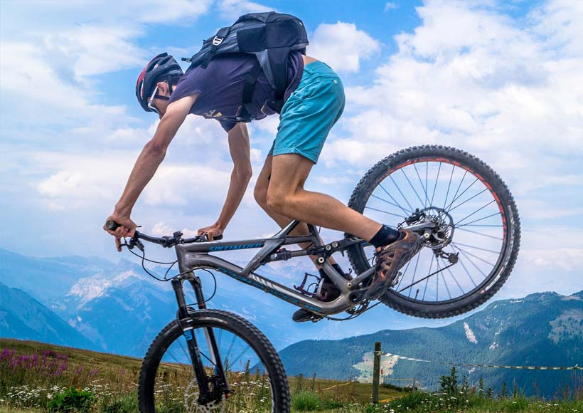 man riding a bike on the mountains
