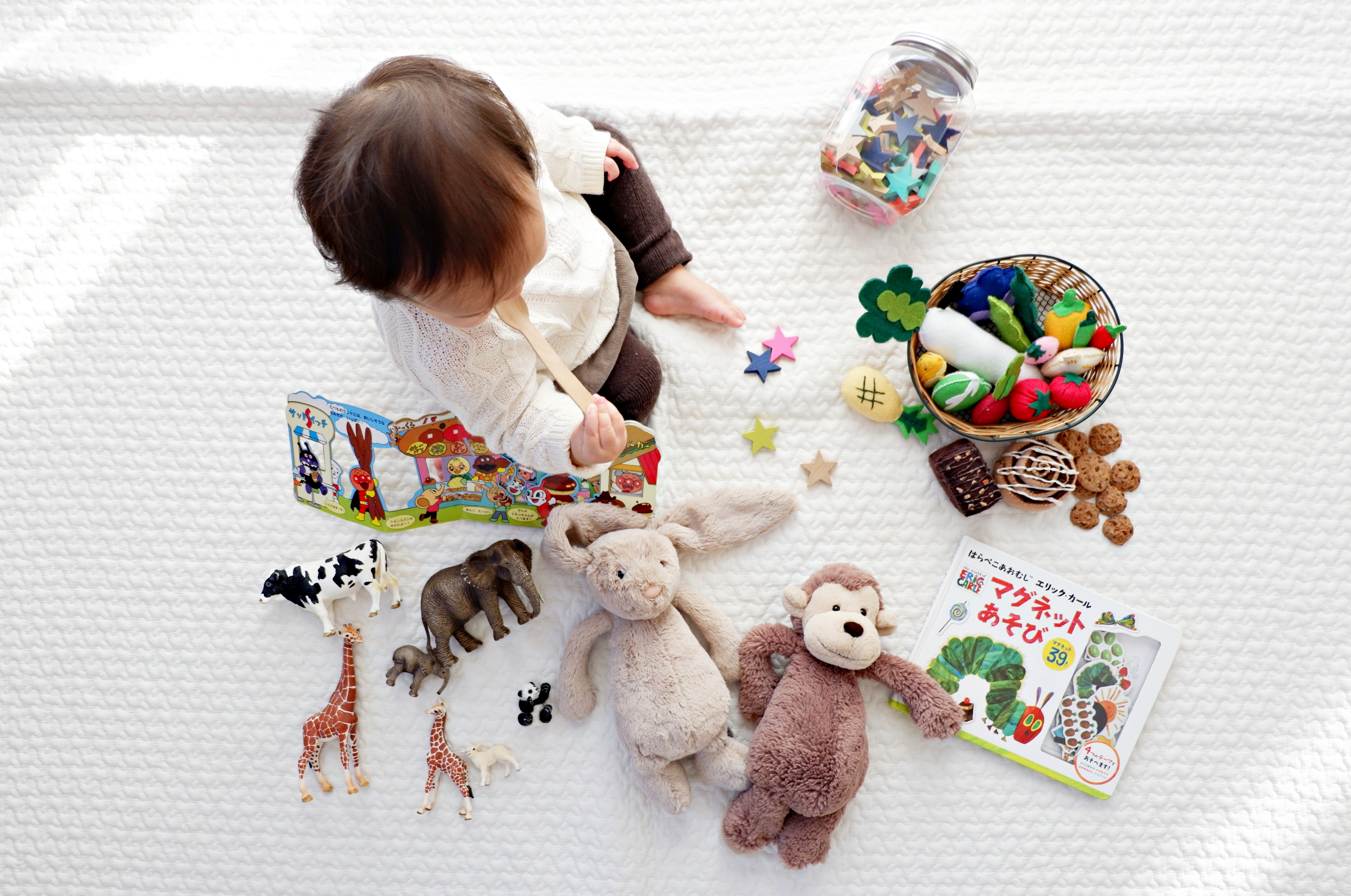 baby sitting with toys